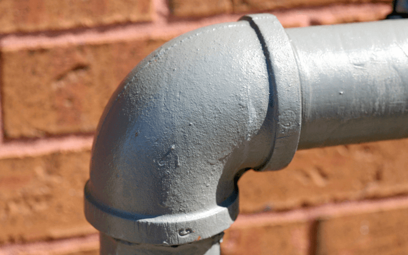image shows a pipe on brickwork