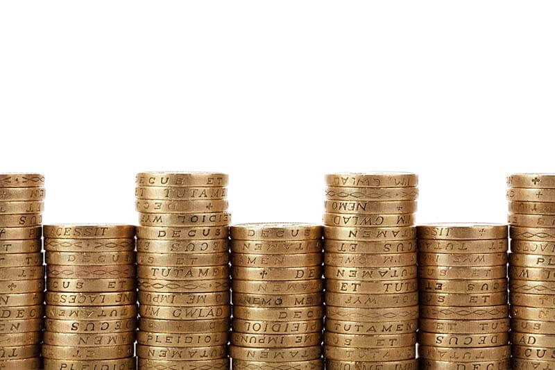 image shows a pile of money to demonstrate a paragraph talking about planning permission costs