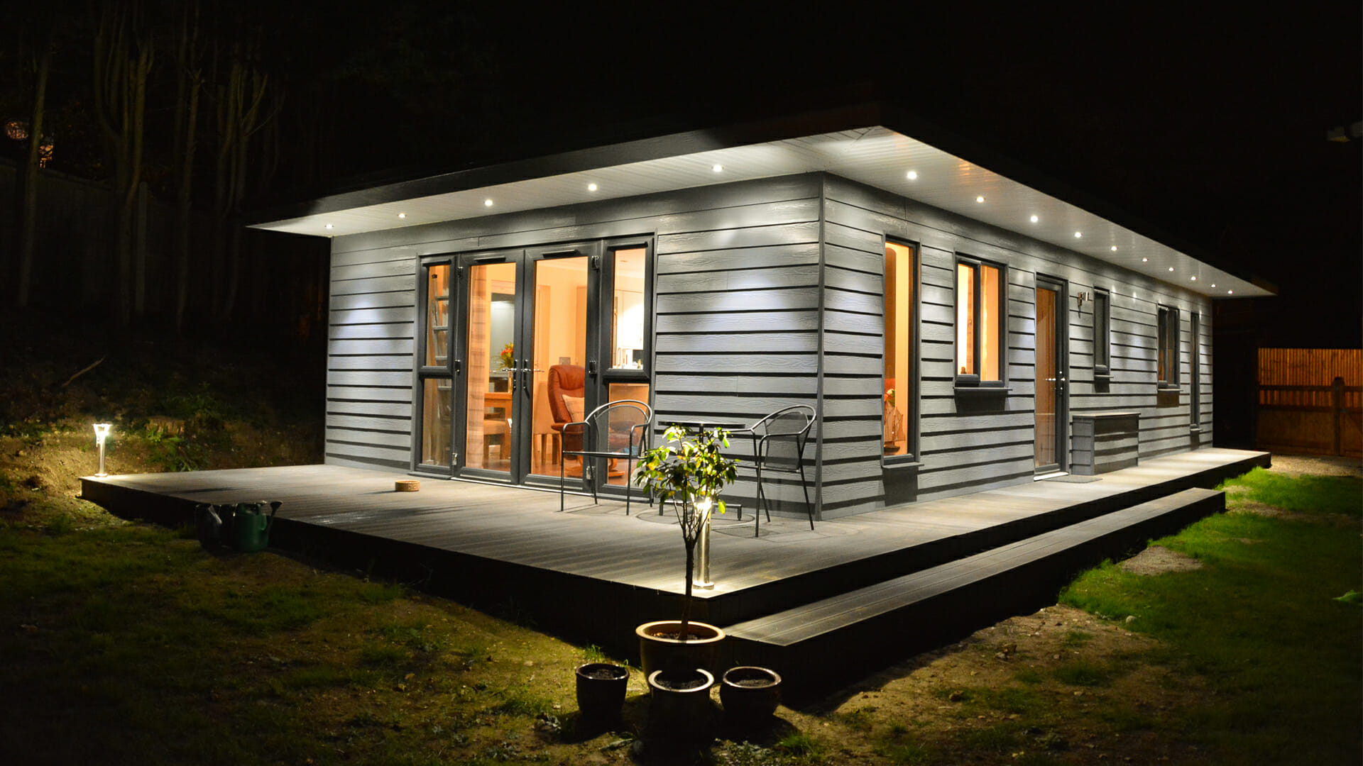 granny annexe ideas image shows a granny annexe with composite decking on the outside