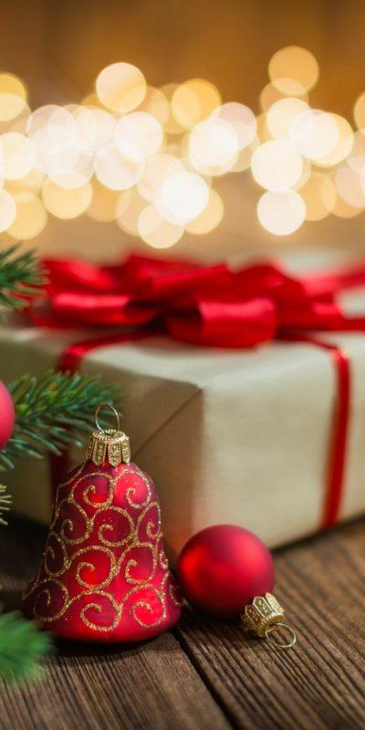 Christmas gift next to tree